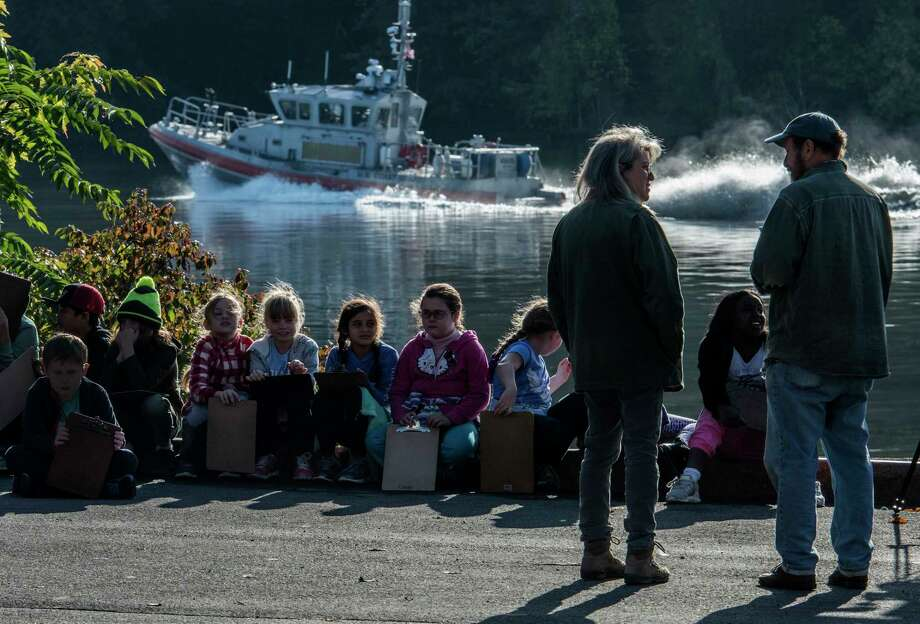 "Students from the Albany Montessori Magnet School line up on the side of Hudson River at the Corning Preserve to become ""scientists for the day"" in the 15th annual Day in the Life of the Hudson and Harbor Thursday Oct. 12, 2017 in Albany, N.Y. Students up and down the Hudson River spend their time collecting and analyzing real data from the field during hands-on exploration of the Hudson River Estuary.   (Skip Dickstein/Times Union) Photo: SKIP DICKSTEIN, Albany Times Union / 20041821A"