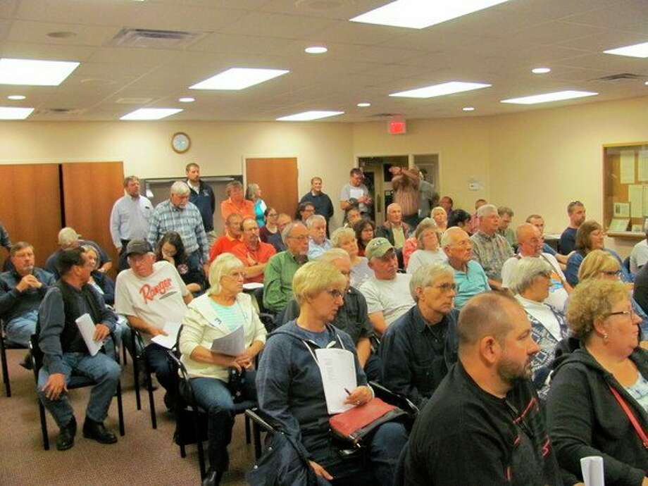 An overflow crowd gathers at the Larkin Township offices to discuss the board's proposed purchase of seven acres for a new fire barn.