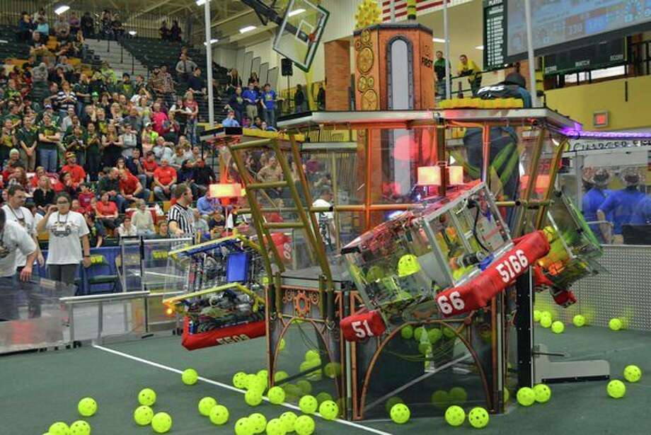 The FIRST Robotics alliance of H.H. Dow, Midland and Freeland high schools climb the airship during a qualification match victory. (Photo provided, file)