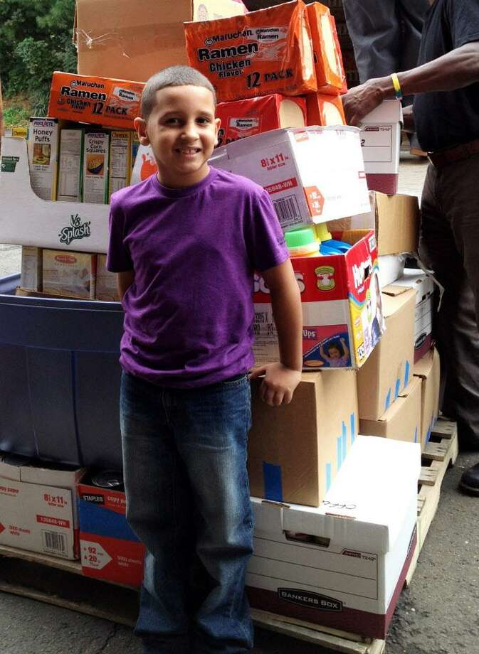 7-year-old Jeremy Rosa of Bridgeport held a food drive that collected 1,053 items, weighing a whopping 997 pounds, the equivalent of 830 meals. The collected food was donated to the Connecticut Food Bank Warehouse in Fairfield, Conn. Photo: Contributed Photo / Contributed Photo / Connecticut Post Contributed