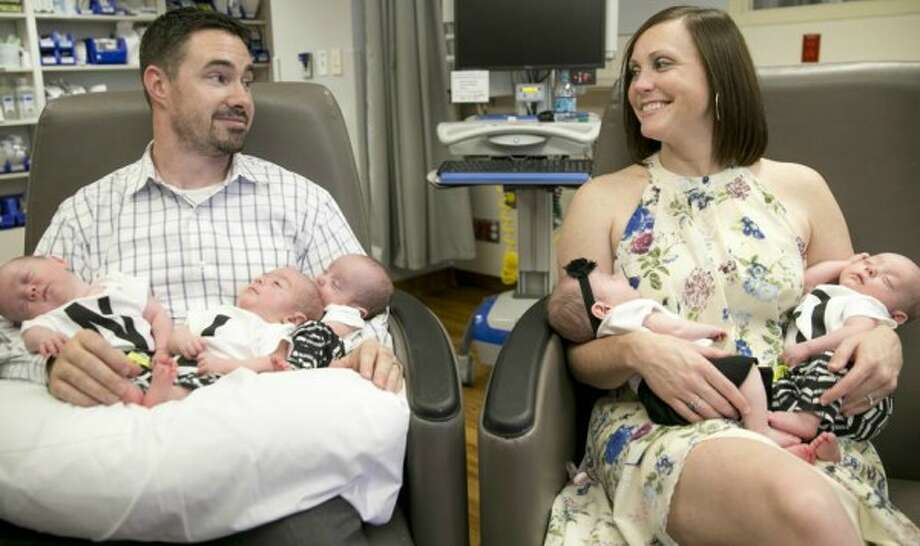 Five babies born to parents Daniel and Liz Hodges, of Temple, Texas, pause before heading home from an Austin hospital in July 2017 (Jay Janner, AUSTIN AMERICAN-STATESMAN).