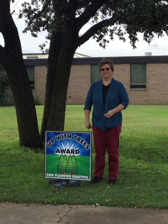First Presbyterian Church, 2101 Utica St., received the Up With Trees Award for October, presented by Tree City USA and the Keep Plainview Beautiful Committee. The church is represented by Karen Hawkins.