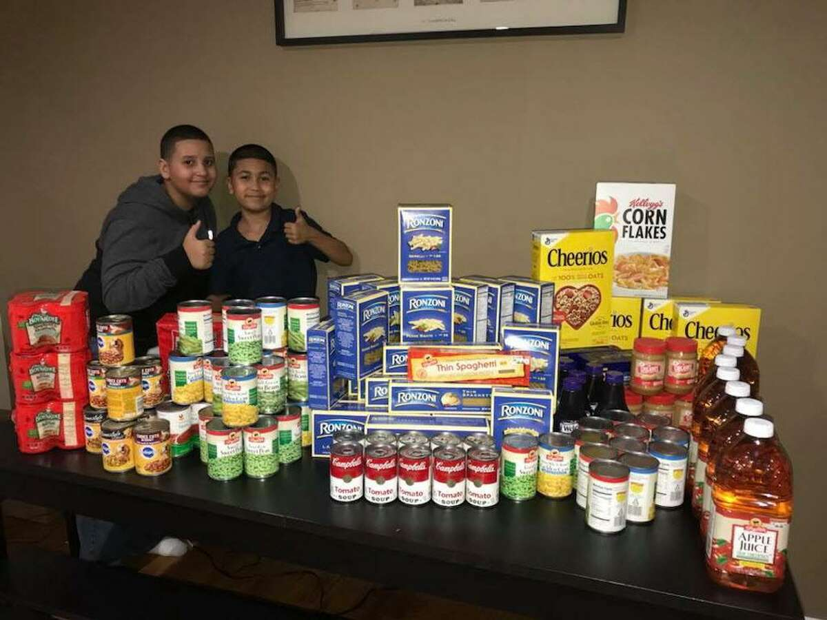Jeremy Rosa and is younger brother Adrian prepare for Jeremy's annual food drive to benefit the Connecticut Food Bank