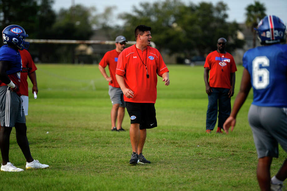 West Brook head football coach Eric Peevey talks to his players during practice on Wednesday. The Bruins head west tonight to take on The Woodlands, who beat them 72-7 last year. Photo taken Tuesday 10/10/17 Ryan Pelham/The Enterprise Photo: Ryan Pelham / ©2017 The Beaumont Enterprise/Ryan Pelham
