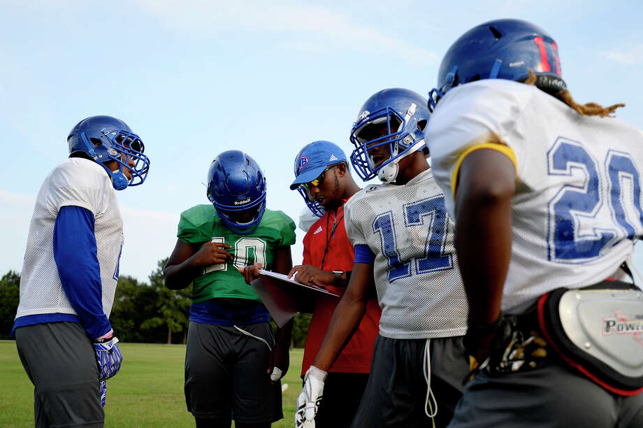 West Brook players run drills during football practice. Click through to see the newly-realigned football, volleyball and basketball districts. Photo: Ryan Pelham / ©2017 The Beaumont Enterprise/Ryan Pelham
