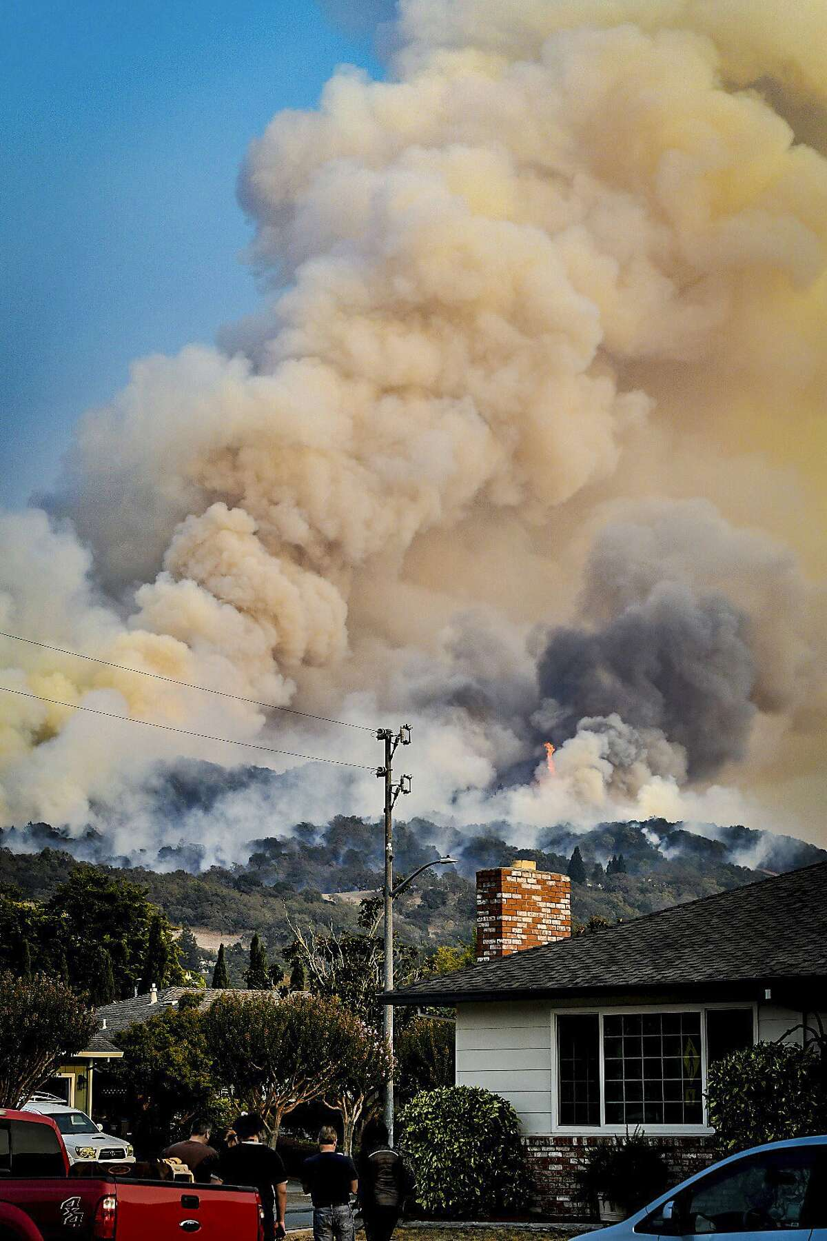 In this Oct. 11, 2017 photo, smoke rises from fires in Santa Rosa, Calif. Gusting winds and dry air forecast for Thursday, Oct. 12, could drive the next wave of devastating wildfires that are already well on their way to becoming the deadliest and most destructive in California history. (Derek Anderson via AP)