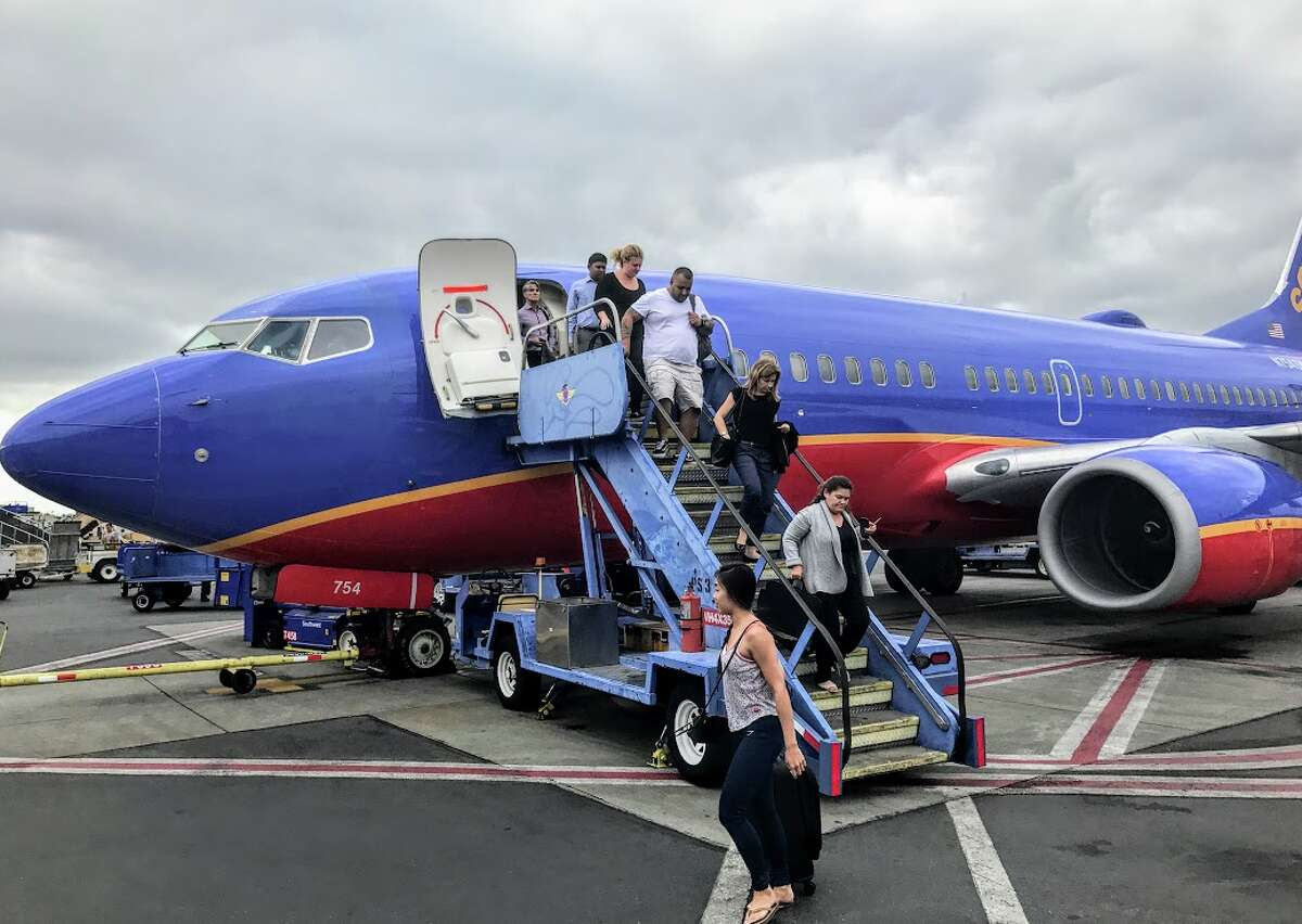 FILE - Passengers exit a Southwest Boeing 737 at Hollywood Burbank Airport.