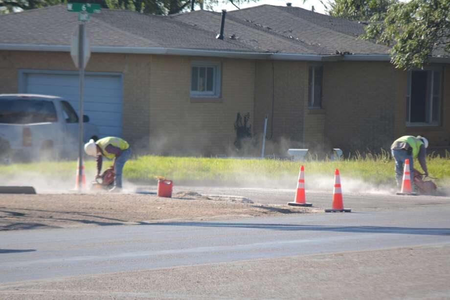 "Work is now under way on a $2.8 million Texas Department of Transportation project to improve curb ramps along several state roadways in Hale and Lamb counties, including SH 194 (Quincy Street), Business I-27 (Columbia Street), FM 400 (Date Street), US 70 (Fifth Street/Olton Road) and FM 3466. The project will add or upgrade ramps to meet Americans with Disabilities Act (ADA) standards. Thursday morning, workers were using saws to cut into the curbs at Sixth and Quincy. Project contractor is Encino Landscape Inc., of Cleveland, Texas. ""Motorists should anticipate various daytime lane closures and are advised to slow down as they enter the work area for their safety and the safety of the workers,"" advises Stevan Perez, P.E., TxDOT Littlefield Area engineer, who is overseeing the project."