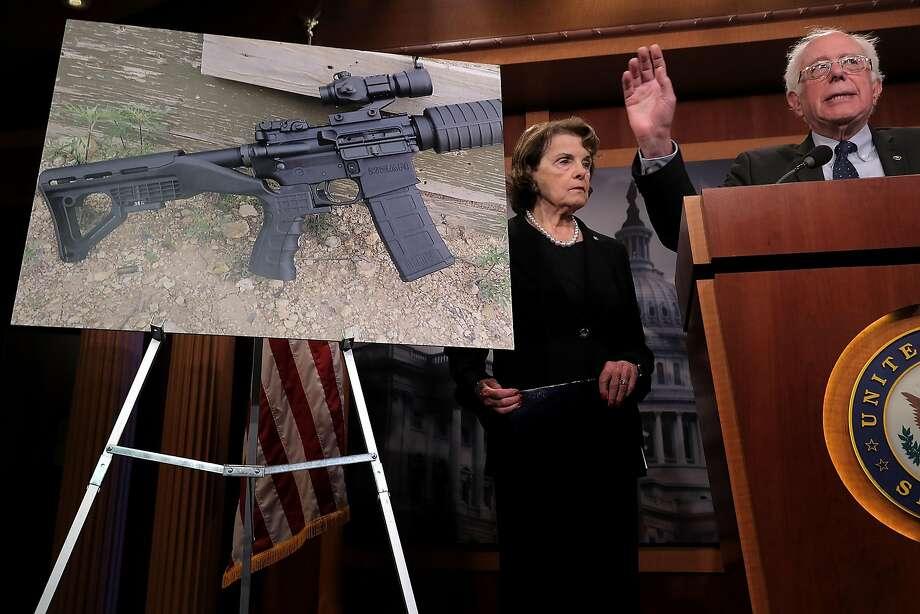 Sen. Dianne Feinstein and Vermont Sen. Bernie Sanders announce proposed gun control legislation after the Las Vegas mass shooting. Photo: Chip Somodevilla