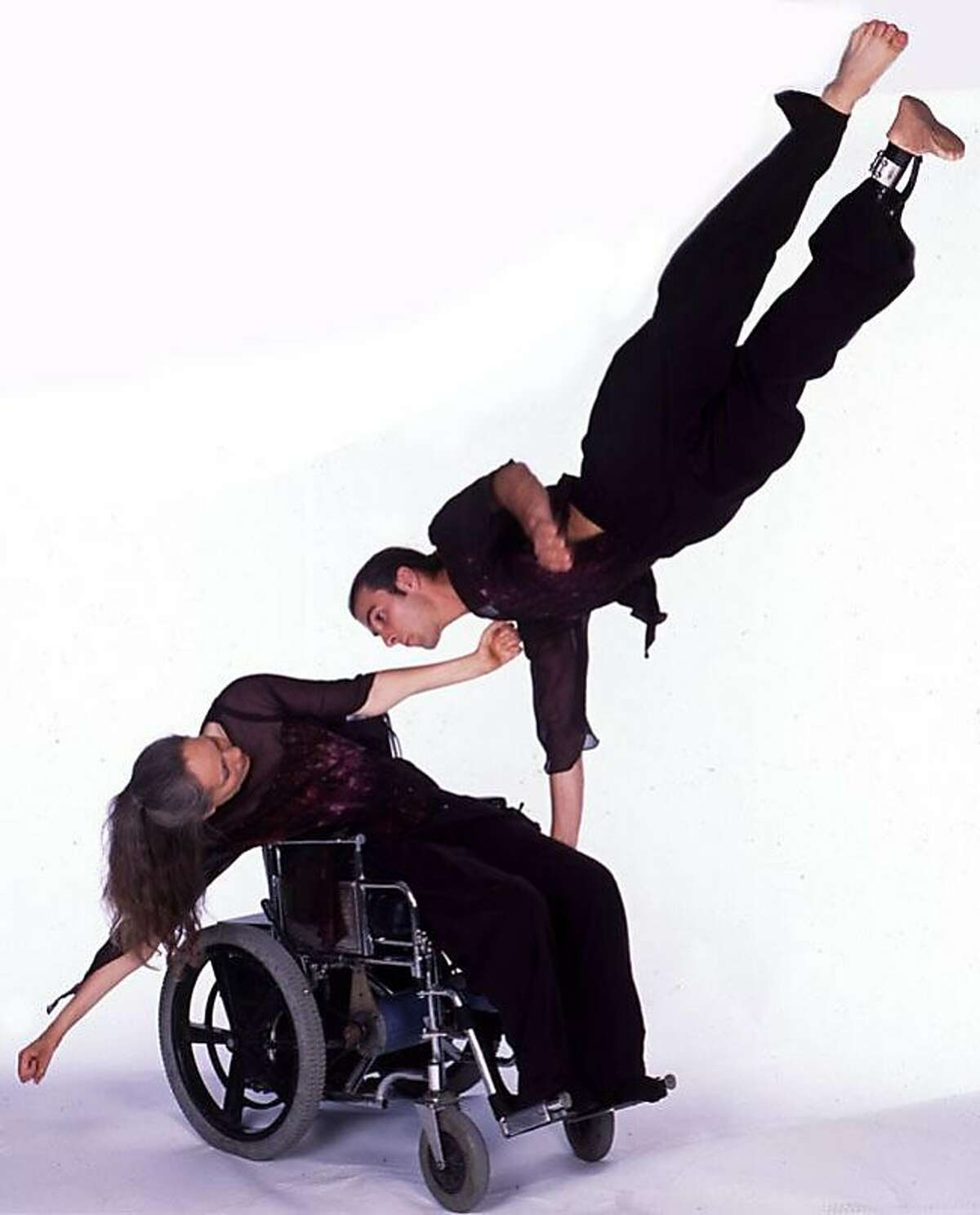 """Judith Smith and Jacques Poulin-Denis of the Axis Dance Company demonstrate a phrase of movement from """"El Ultimo Adios,"""" a dance the Oakland troupe will perform at the coming """"Ever widening Circle"""" benefit ; Photo credit: Margot Hartford ; on 6/19/02 in ."""