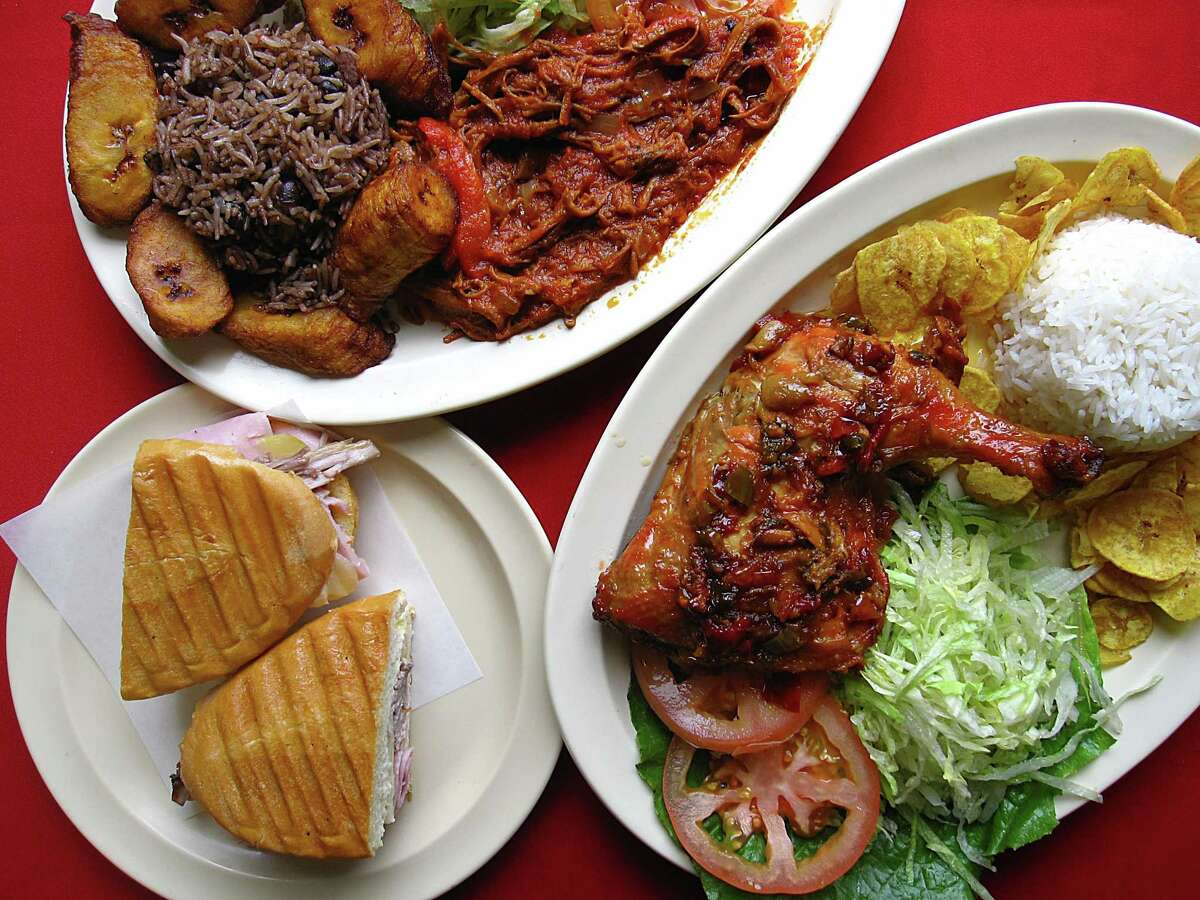 A Cubano sandwich, bottom left, a ropa vieja platter with fried plantains and congri and a dish called Guajira Chicken with fried plantain chips and white rice from Guajira Cuban Restaurant.