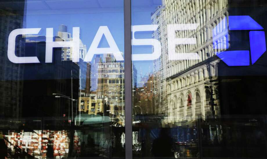 A Chase bank branch in New York. JPMorgan Chase & Co.'s third-quarter results kicked off the industry's earnings season. An increase in corporate loans, the highest lending margin in  4 1/2 years and record profit in asset management helped the lender top analysts' estimates. Photo: Associated Press File Photo / Copyright 2017 The Associated Press. All rights reserved.