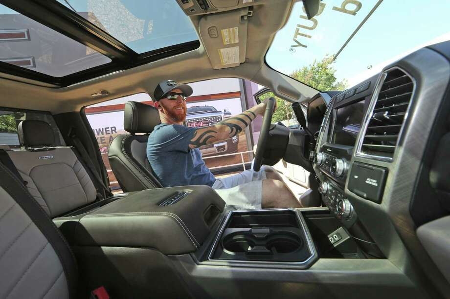 A man looks at the interior of a fully-loaded F-450 Super Duty Limited, the biggest version of the Ford F-Series, on display at the State Fair of Texas in Dallas on Monday.  Buyers are increasingly outfitting their pickups with all the comforts of luxury cars. Photo: LM Otero /Associated Press / Copyright 2017 The Associated Press. All rights reserved.