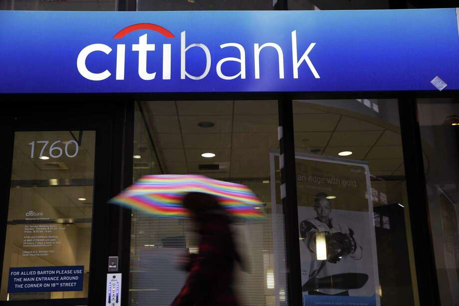 A person walks past a Citibank location in Philadelphia. Citigroup said it earned $4.13 billion, or $1.42 per share, compared with a profit of $3.84 billion, or $1.24 per share, in the same period a year earlier. Photo: Associated Press File Photo / AP