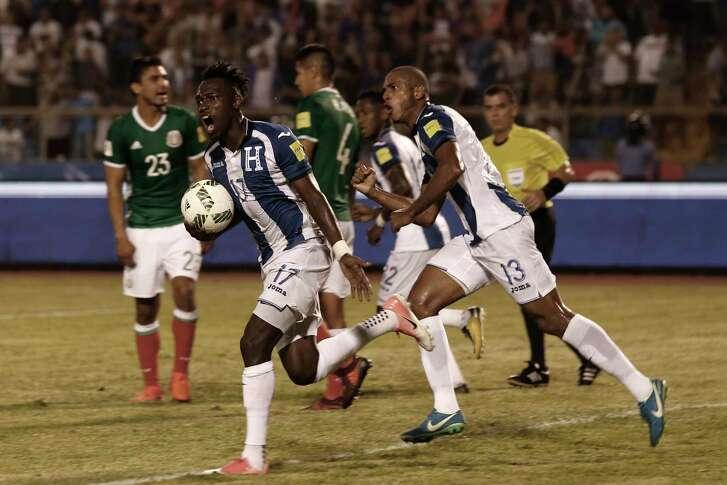 Honduras' Alberth Elis (17) celebrates after his team Honduras' Romell Quioto scored against Mexico, during a World Cup qualifying soccer match in San Pedro Sula, Honduras, Tuesday, Oct. 10, 2017. (AP Photo/Moises Castillo)