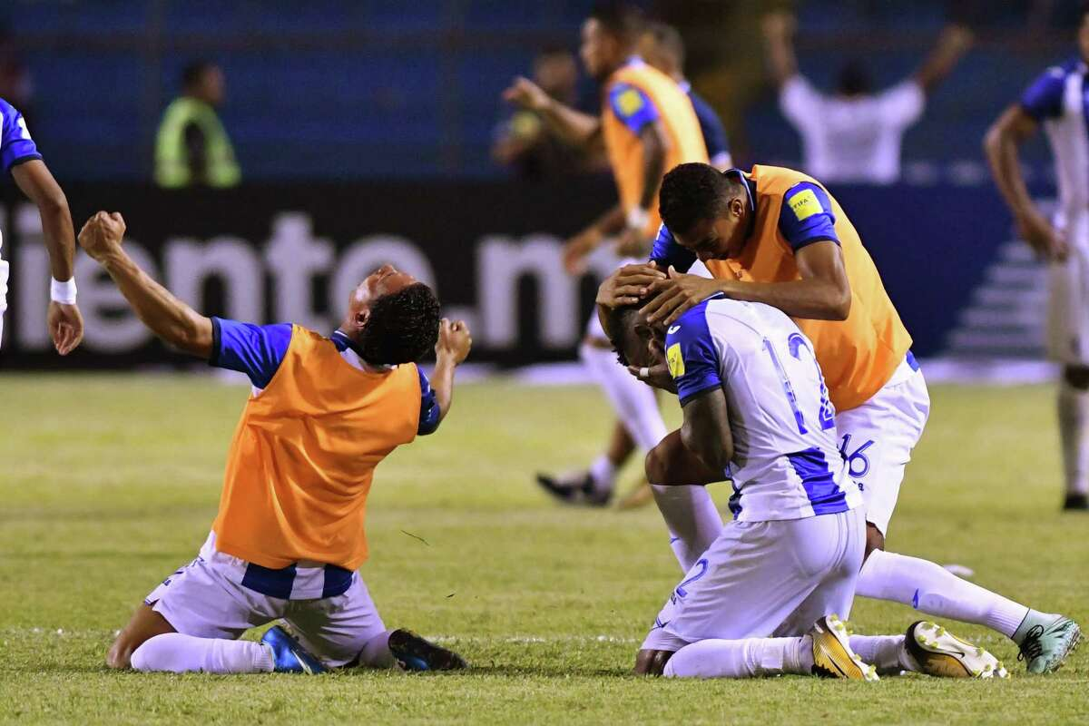 Honduras' Romell Quioto (R) celebrates with teammates after scoring against Mexico during their 2018 World Cup qualifier football match, which they won, in San Pedro Sula, Honduras, on October 10, 2017. / AFP PHOTO / JOHAN ORDONEZJOHAN ORDONEZ/AFP/Getty Images