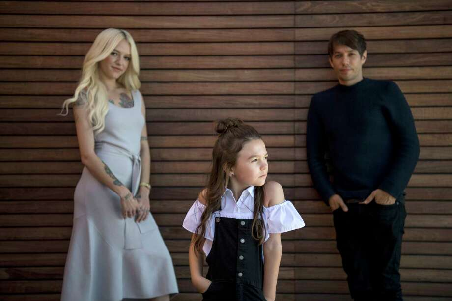 """Bria Vinaite, left, and Brooklynn Prince, center, who star in """"The Florida Project,"""" with the film's director, Sean Baker. Photo: Washington Post Photo By Carolyn Van Houten / The Washington Post"""