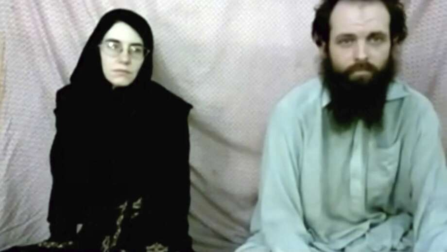This still image made from a 2013 video released by the Coleman family shows Caitlan Coleman and her husband, Canadian Joshua Boyle in a militant video given to the family. The American woman, her Canadian husband and their three young children have been released in October 2017 after years of being held captive by a network with ties to the Taliban. The two were abducted five years ago while traveling in Afghanistan and have been held by the Haqqani network. The couple had three children while in captivity. (Coleman family via AP) Photo: Associated Press