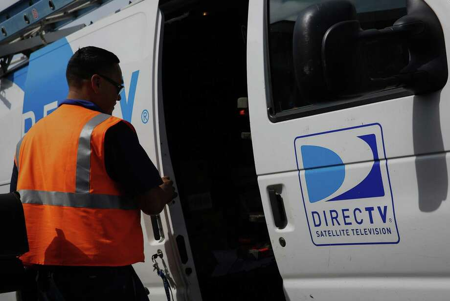 A DirecTV technician retrieves equipment from a truck while installing a new satellite TV system at a home in Compton, California. Barring a major fourth-quarter comeback, 2017 is on course to be the worst year for conventional pay-TV subscriber losses in history, surpassing last year's 1.7 million, according to Bloomberg Intelligence. Photo: Bloomberg News File Photo / © 2014 Bloomberg Finance LP
