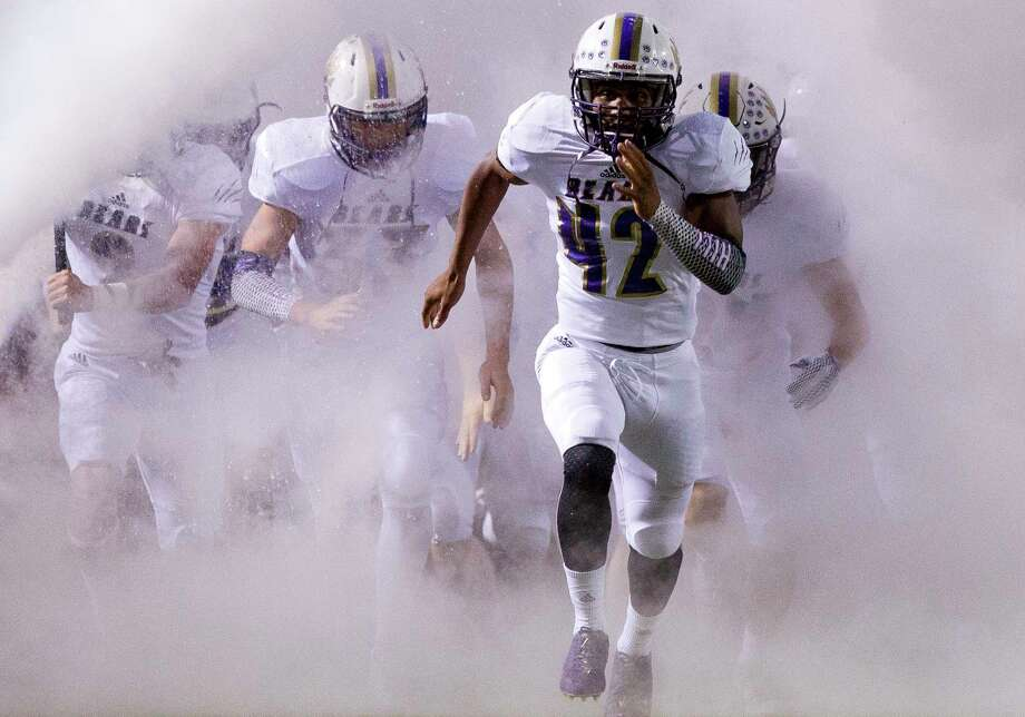 Montgomery defensive tackle Kenyura Hill (42) leads the team onto the field before a District 12-6A high school football game against Oak Ridge at Woodforest Bank Stadium, Friday, Oct. 6, 2017, in Shenandoah. Photo: Jason Fochtman, Staff Photographer / © 2017 Houston Chronicle