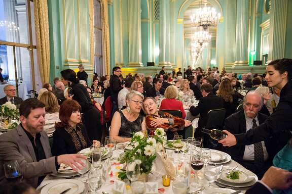Guests of the annual benefit gala for Opera Parall�le sit down to dinner and a performance that was interspersed with the meal at the War Memorial Green Room in San Francisco, Calif., on Wednesday, October 11, 2017. The San Francisco based non-profit develops and performs contemporary chamber opera.
