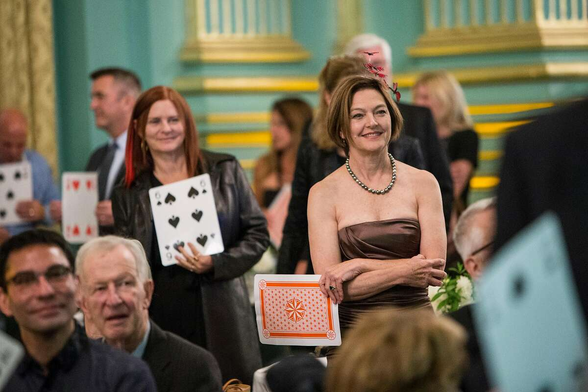 Suzanne Vaucher (right) and other guests of the annual benefit gala for Opera Parall�le stand during a drawing to win a collection of wine at the War Memorial Green Room in San Francisco, Calif., on Wednesday, October 11, 2017. The San Francisco based non-profit develops and performs contemporary chamber opera.