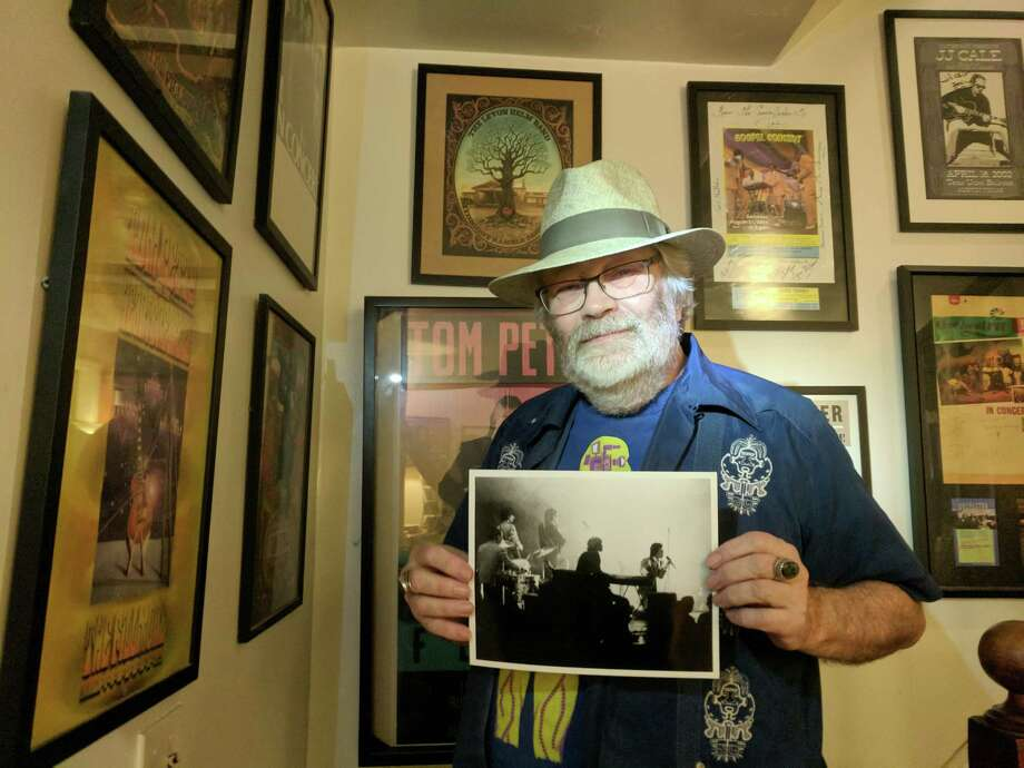 "Joe Compton is pictured in his Baltimore home with the photo that he took of the Rolling Stones playing Otis Redding's ""That's How Strong My Love Is."" Photo: Laurie DeWitt, Pure Light Images / Pure Light Images"