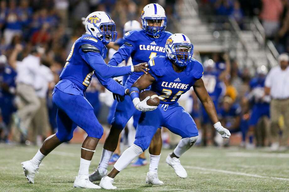 Clemens' Johnie Graham (right) celebrates after intercepting a pass during the second half of their non-district game with MacArthur at Lehnhoff Stadium on Sept. 8, 2017. Photo: Marvin Pfeiffer /San Antonio Express-News / Express-News 2017