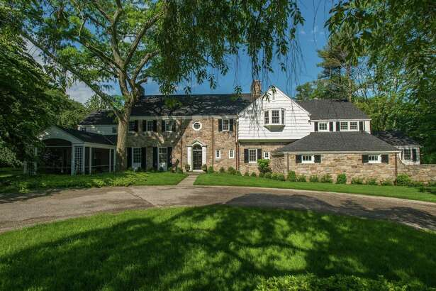The elegance of old Hollywood meets the 21st century in the shingle-and-stone Georgian colonial-style house at 1102 Oenoke Ridge Road.