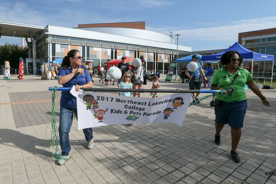 "Kids, pets and mascots march in the Kids & Pets parade as Northeast Lakeview College celebrated its 10th anniversary of opening its doors with Celebrate 10 at the school on Sept. 30. The event was designed for the municipalities largely served by the school —Universal City, Live Oak, Converse, Cibolo, Schertz and Selma, which give the school ""great support,"" said Northwest Lakeview President Veronica Garcia. Photo: Photos By Marvin Pfeiffer /San Antonio Express-News / Express-News 2017"
