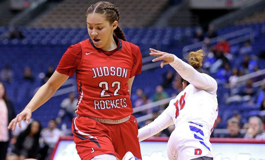 Judson's Kyra White looks for room around Duncanville's Nina Alvarez during first half action of their Class 6A state semifinal game held Friday March 3, 2017 at the Alamodome. Photo: Edward A. Ornelas, Staff / San Antonio Express-News / © 2017 San Antonio Express-News