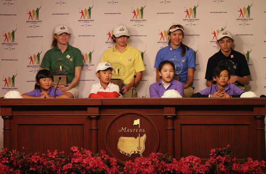 AUGUSTA, GA - APRIL 06:  (L-R) Front row: Kelly Xu, Treed Huang, Lucy Li, Leo Cheng;  Back row: Natalie Pietromonaco, Bryson Bianco, Hunter Pate and Patrick Welch face the media after winning their categories in the National Finals of the Drive, Chip and Putt Championship at Augusta National Golf Club on April 6, 2014 in Augusta, Georgia.  (Photo by Andrew Redington/Getty Images) Photo: Andrew Redington, Staff / ONLINE_YES