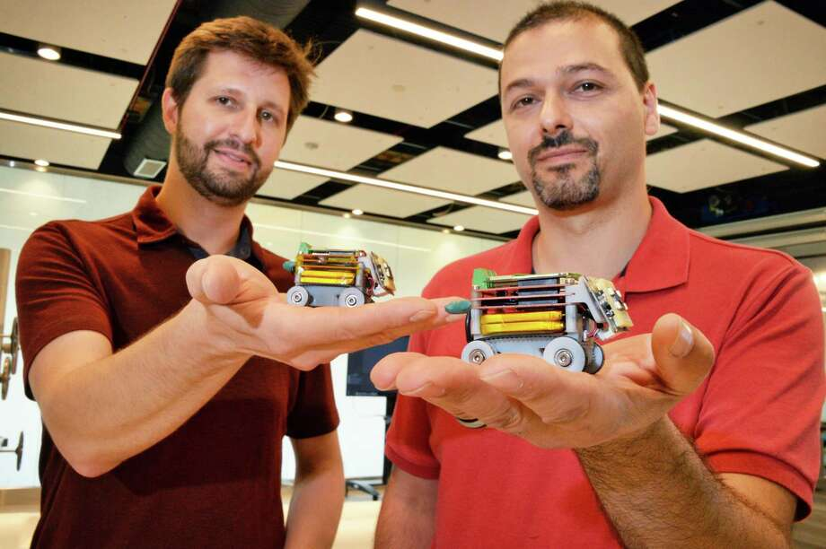 GE scientists and robotics researchers Todd Danko, left, and Don Lipkin with mini robots at GE Global Research Center Wednesday Oct. 11, 2017 in Niskayuna, NY.  (John Carl D'Annibale / Times Union) Photo: John Carl D'Annibale, Albany Times Union / 20041811A