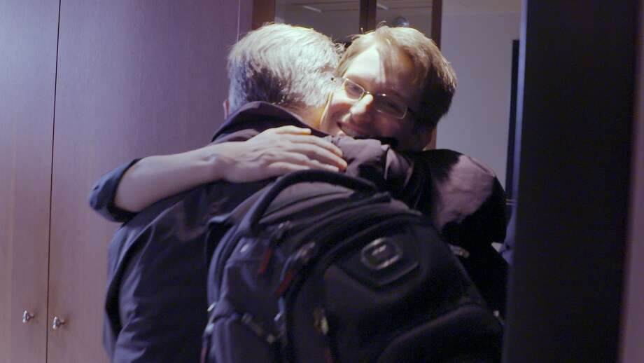 """Edward Snowden (right) meets Larry Lessig in """"Meeting Snowden,"""" a documentary directed by Flore Vasseur. Photo: UNAFF"""