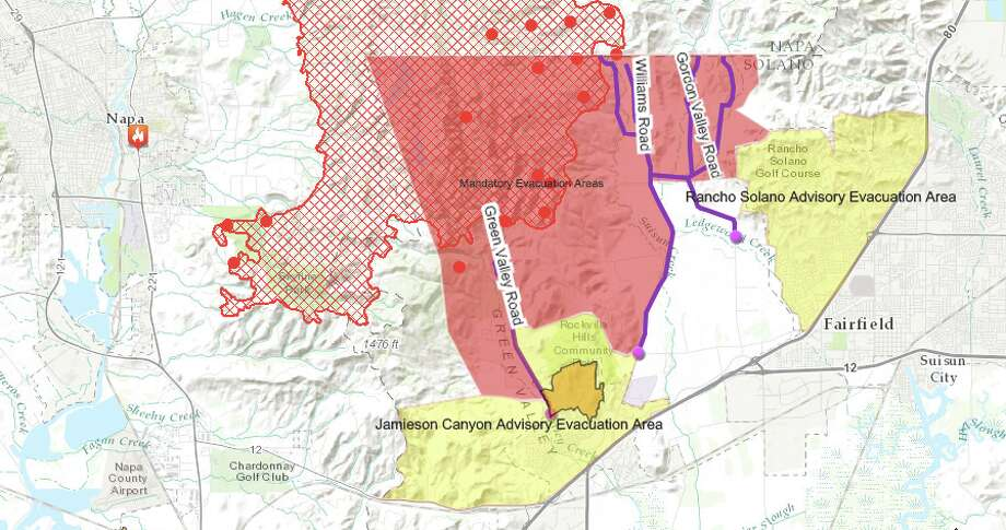 A map shows the boundaries of the Atlas fire as of Thursday at 12:30 p.m. The solid red areas denote the mandatory evacuation zone, yellow areas are advisory evacuation zones, and the red grid shows the area of the active fire. For a live map click here. Photo: Solano County OES
