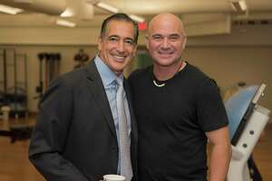 Bahram Akradi,  founder and CEO of Life Time, with his friend tennis great Andre Agassi at the grand opening of Life Time Tennis and Athletic Galleria, formerly Galleria Tennis & Athletic Club.