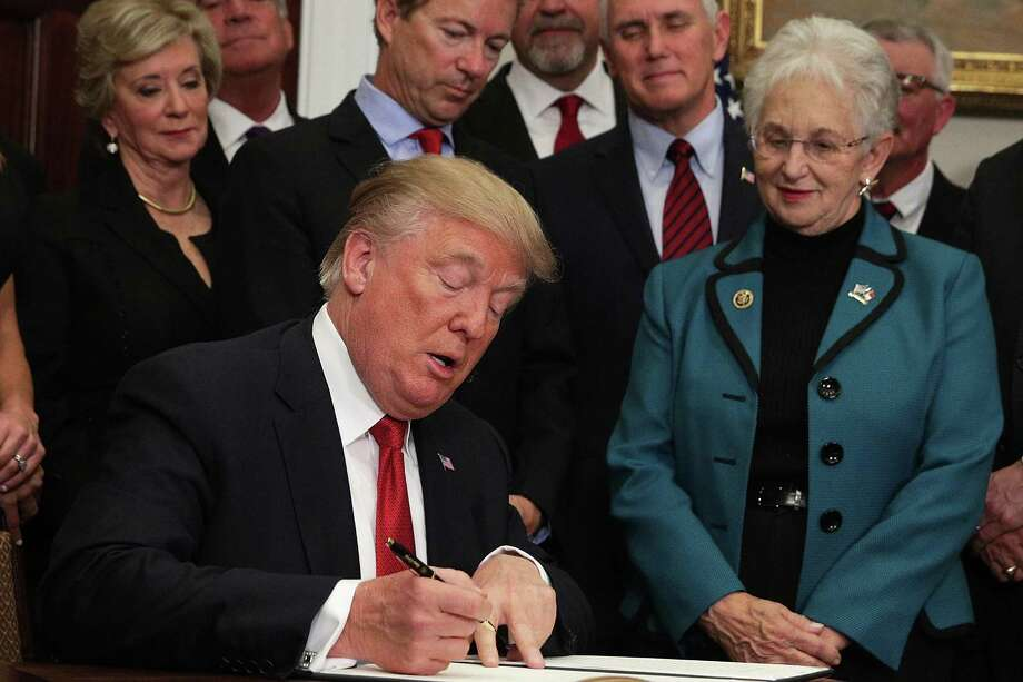 "WASHINGTON, DC - OCTOBER 12:  U.S. President Donald Trump signs an executive order as Sen. Rand Paul (R-KY), Vice President Mike Pence, and Rep. Virginia Foxx (R-NC) look on during an event in the Roosevelt Room of the White House October 12, 2017 in Washington, DC. President Trump signed the executive order to loosen restrictions on Affordable Care Act ""to promote healthcare choice and competition.""  (Photo by Alex Wong/Getty Images) Photo: Alex Wong / Getty Images / 2017 Getty Images"