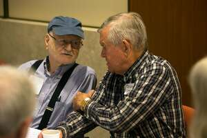 Gus Haas, 90, left, and Barney Johnson, 85, both forced to flee the fires in Santa Rosa, Calif. commiserate with their fellow evacuees at St. Paul's Towers, Wednesday, Oct. 11, 2017 in Oakland, Calif. More than 60 evacuees have been relocated to the facility as fires continue to rage through the North Bay.