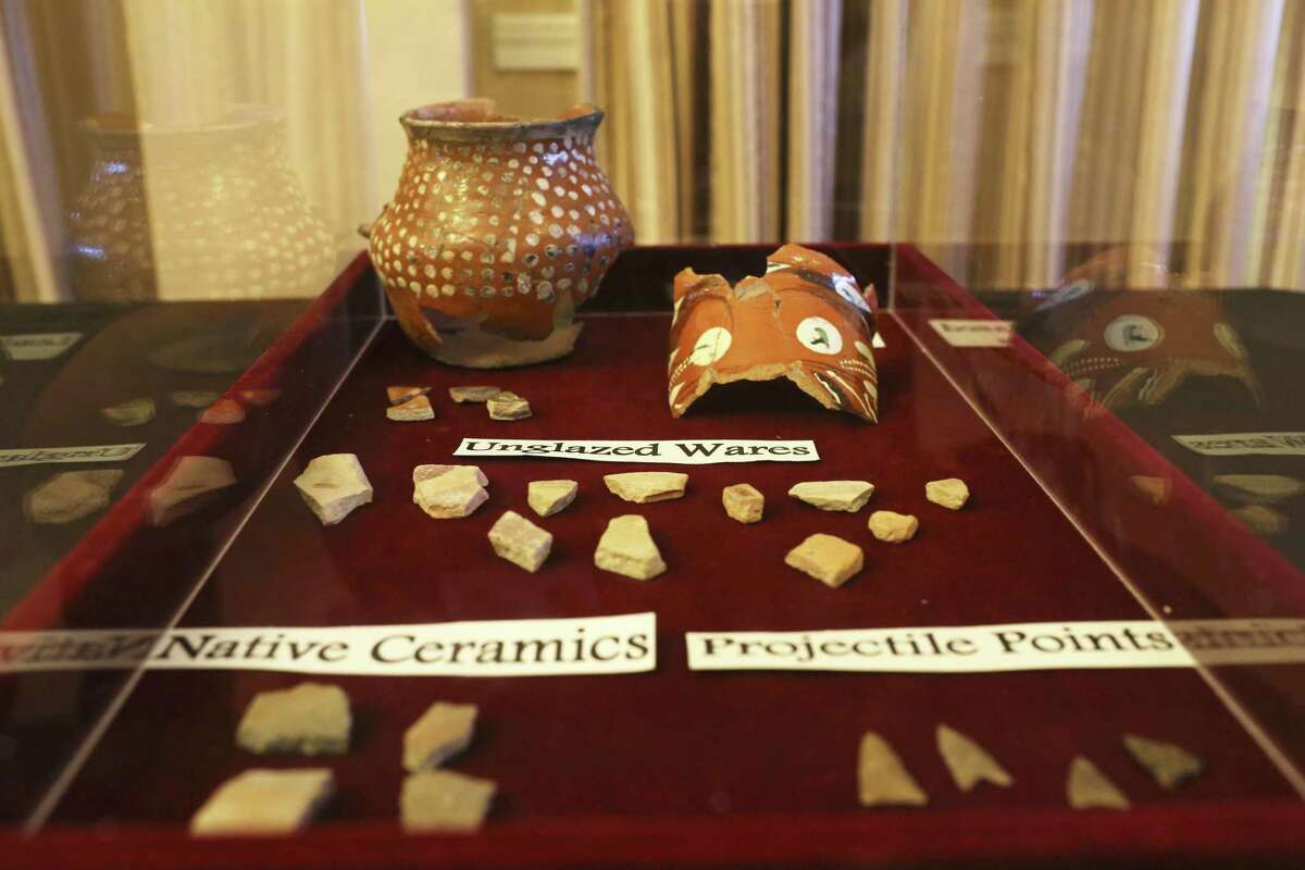 A case displaying ceramic pieces was part of a one-day display of artifacts unearthed in past excavation at the Alamo and neaby Thursday. The display was in celebration of Texas Archeology Month.