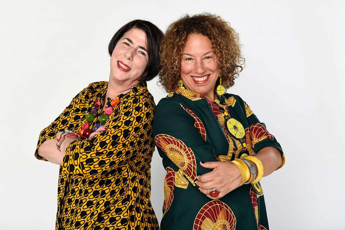 """Audrey Ferber, left, wears a Zuri dress named """"Jupiter"""" as Soad Kader, left, wears a Zuri dress named """"Breezy"""" while they poses for a portrait in San Francisco, Calif., on Friday, October, 6, 2017."""