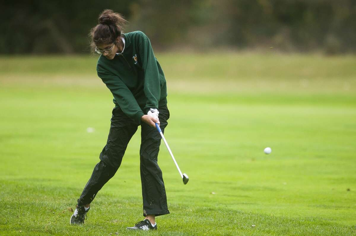 Dow's Rose Hami competes in the Division 2 regional golf meet on Thursday at Currie Golf Course. (Katy Kildee/kkildee@mdn.net)