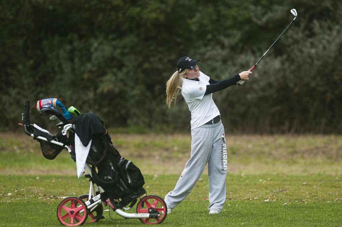 Dow's Alexis Carras competes in the Division 2 regional golf meet on Thursday at Currie Golf Course. (Katy Kildee/kkildee@mdn.net)