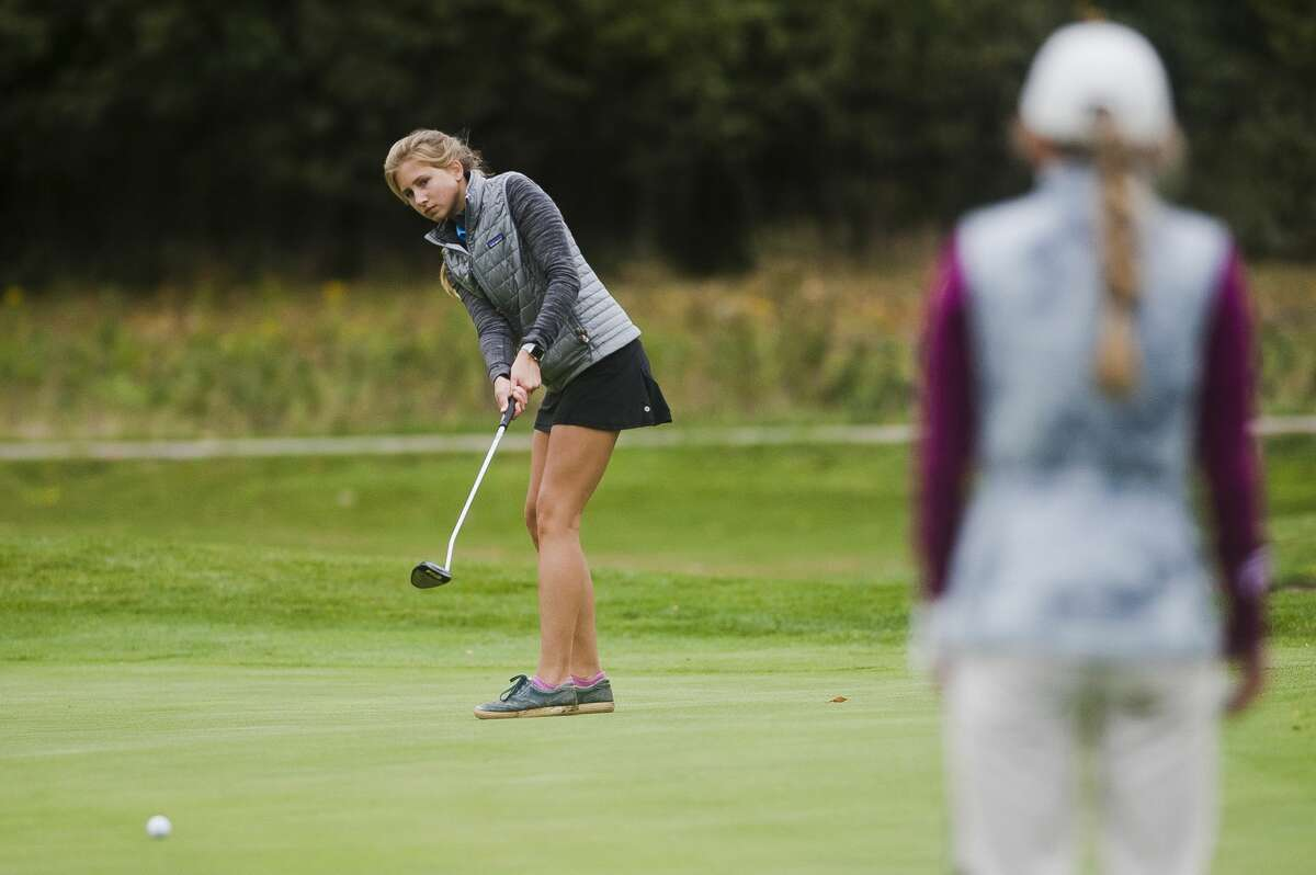 Midland's Meg Gandy competes in the Division 2 regional golf meet on Thursday at Currie Golf Course. (Katy Kildee/kkildee@mdn.net)