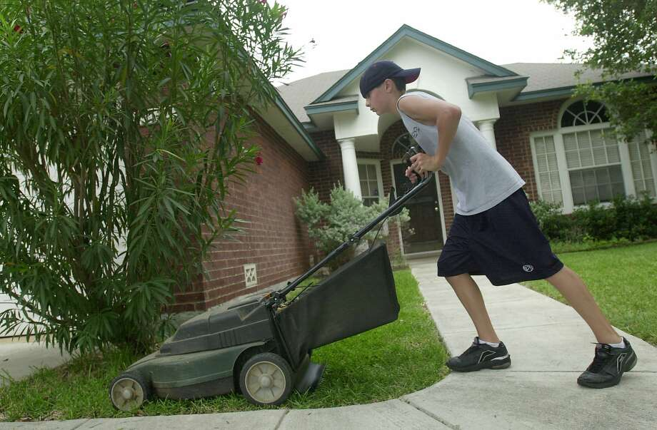 FILE — Q: I walk the neighborhood 2-3 miles a day for exercise. I notice the grass is starting to get high. But, I don't see anyone mowing grass. I know lawn service businesses are not in practice, because they're a non-essential service/business, but is mowing your own grass OK, or does it technically violate the existing Michigan executive orders? (Hearst file) Photo: CARRIE J. JENSEN, EXPRESS-NEWS FILE PHOTO