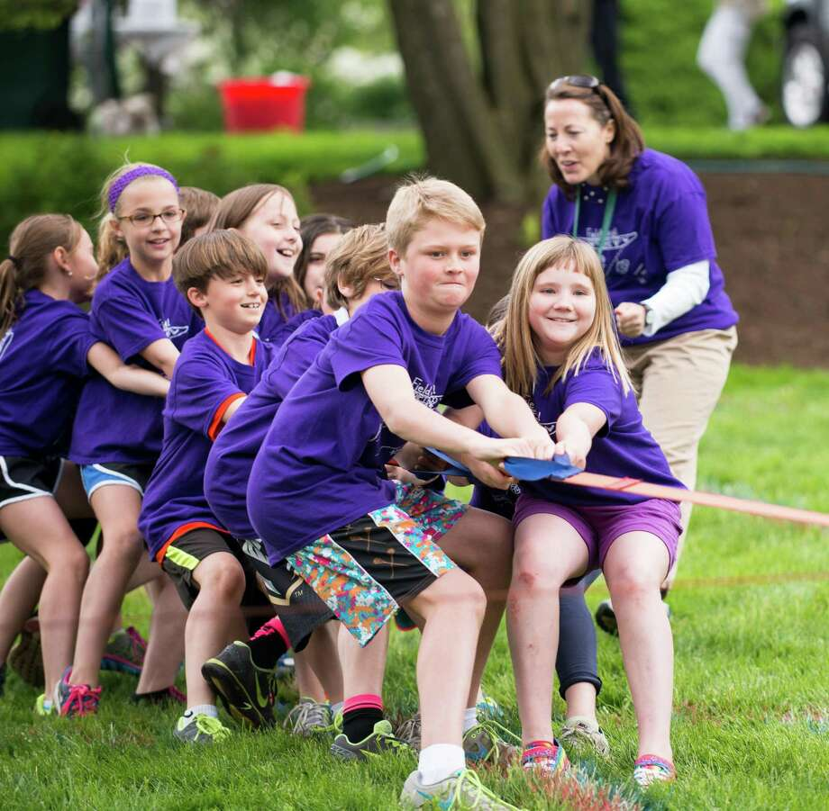 On Field Day at Pear Tree Point School last year Lanie Durkin, Holly Silva, Dagny Streit, Baker Beck, Gracie Barker and Sam Eglin, from left to right, put forth great effort to dislodge the red team in the final tug-o-war event. Photo: Contributed / Darien News