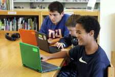 Anderson Campbell and his fellow sixth-grade students on their Chromebooks in the Middlebrook School Library.