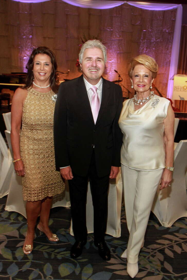 Regina Garcia, from left, Steve Tyrell and Philamena Baird at the Memorial Hermann Razzle Dazzle luncheon at the Westin Memorial City. Regina and Philamena are the event's chairs.  (For the Chronicle/Gary Fountain, October 12, 2017)