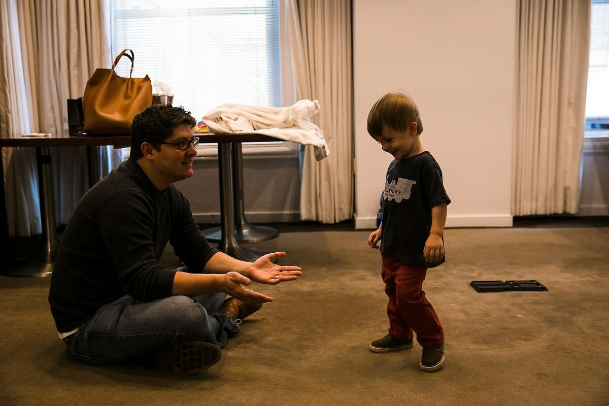 Luciano Tristan, played with his one-year-old son, Luca Tristan, in a meeting room where the family spent the night at the Clift Hotel in San Francisco, Calif. Thursday, October 12, 2017.