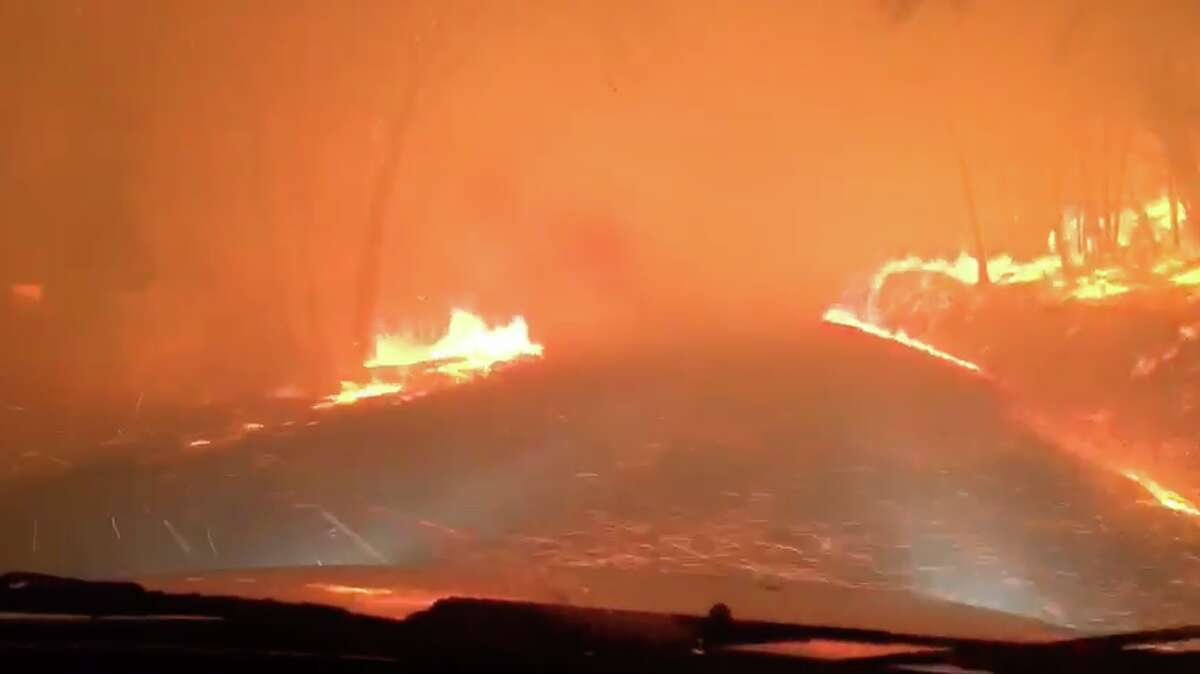 A screenshot from the video shows the dangerous conditions Andre Epstein and Neda Monshat drove through to escape the wildfire early Monday morning.