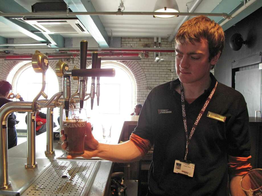 A bartender pours a pint in 2009 at the Guinness Storehouse in Dublin, Ireland. Credit: Amy Laughinghouse. Photo: Amy Laughinghouse / For The Chronicle / Freelance